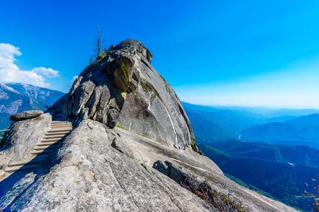 Hike on Moro Rock Staircase toward mountain top, granite dome rock formation in Sequoia National Park, Sierra Nevada mountains, California, USA Stock Photo
