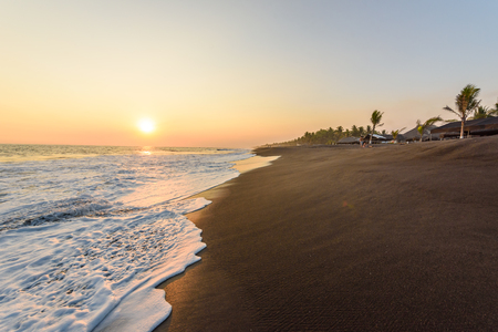 Sunset at Beach with Black Sand in Monterrico, Guatemala. Monterrico is situated on the Pacific coast in the department of Santa Rosa. Known for its volcanic black sand beaches and annual influx of sea turtles. Travel destination of Guatemala.