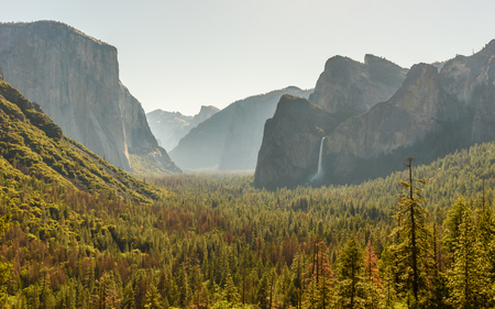 View of Yosemite Valley from Tunnel View point at sunrise - view to Bridalveil falls, El Capitan and Half Dome - Yosemite National Park in California, USA
