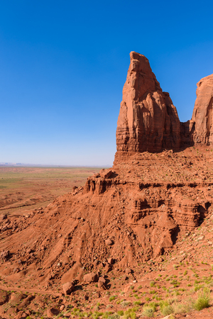 Scenic Drive on Dirt Road through Monument Valley, The famous Buttes of Navajo tribal Park, Utah - Arizona, USA. Scenic road and red rock formations. Stock Photo