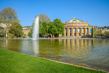 Stuttgart State Theatre Opera building and fountain in Eckensee lake, Germany Editorial