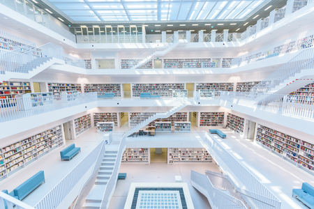Modern Public City Library - STUTTGART, GERMANY - White interior with many white staircases. Beautiful mordern architecture.
