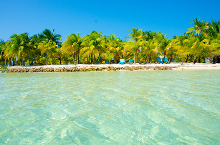 South Water Caye in Belize - small caribbean paradise island with tropical beach for vacation and relaxing