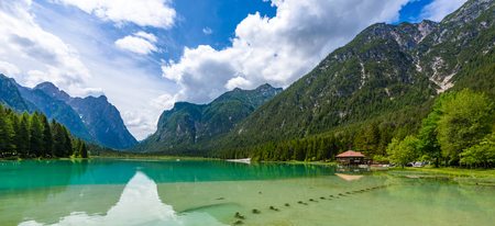 Lake Dobbiaco (Toblacher See, Lago di Dobbiaco) in Dolomite Alps, South Tirol, Italy - Travel destination in Europe Reklamní fotografie