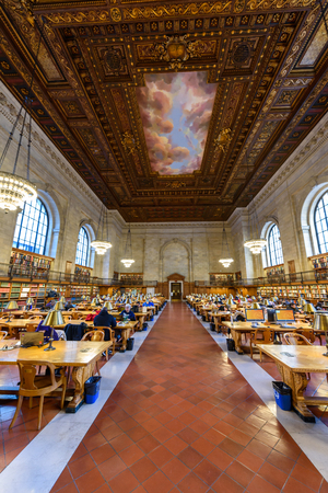 NEW YORK CITY - December 12: people study in the New York Public Library on December 12, 2017 in Manhattan, New York City. Rose Main Reading Room wide angle in Public Library New York, USA.