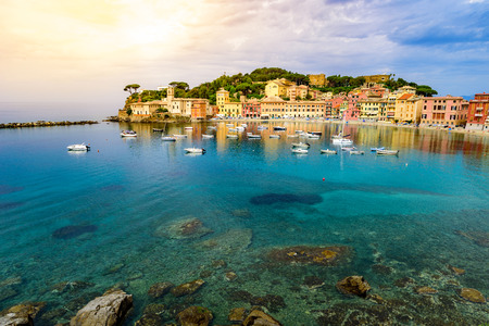 Sestri Levante - Paradise Bay of Silence with its boats and its lovely beach. Beautiful coast at Province of Genoa in Liguria, Italy, Europe. Фото со стока