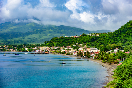Paradise coast at Saint Pierre with Mt. Pelee, active volcanic mountain in Martinique, Caribbean Sea Stock Photo