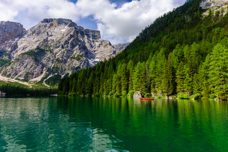 Lake Braies (also known as Pragser Wildsee or Lago di Braies) in Dolomites Mountains, Sudtirol, Italy - Europe. Romantic place with typical wooden boats on the alpine lake.