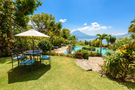 Paradise beach with chair at lake Atitlan, Panajachel - Relaxing and recreation with vulcano landscape scenery in the highlands of Guatemala