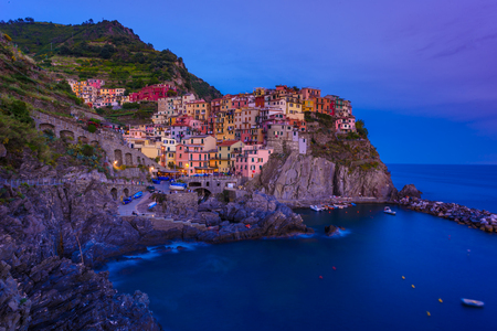 Manarola - Village of Cinque Terre National Park on Ligurian coast of Italy. Beautiful colors at sunset. Province of La Spezia, Liguria, in the north of Italy, Europe.