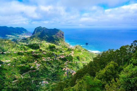 Landscape scenery from Portela Viewpoint - Porto da Cruz at beautiful coast and mountains in the north of Madeira island - Ribeira Frio-Portela, Portugal. Stok Fotoğraf