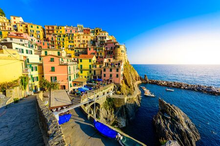 Colorful houses in Manarola Village in Cinque Terre National Park. Beautiful scenery at coast of Italy. Fisherman village in the province of La Spezia, Liguria, Italy Stok Fotoğraf