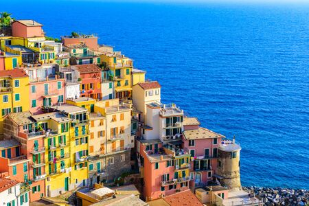 Colorful houses in Manarola Village in Cinque Terre National Park. Beautiful scenery at coast of Italy. Fisherman village in the province of La Spezia, Liguria, Italy Stock Photo