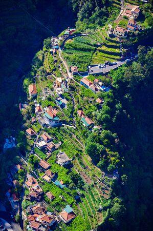 View from Eira do Serrado to Curral das Freiras village in the Nuns Valley in beautiful mountain scenery, municipality of Câmara de Lobos, Madeira island, Portugal. Stock Photo
