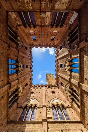 Siena - View from inside the Palazzo Pubblico at Piazza del Campo - old historic city in Italy