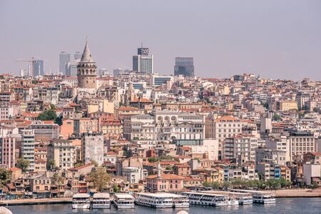 Cityscape of Istanbul at Golden Horn. Panorama of the old town with Galata tower in Karakoy District, Turkey. Touristic Destination in Europe.