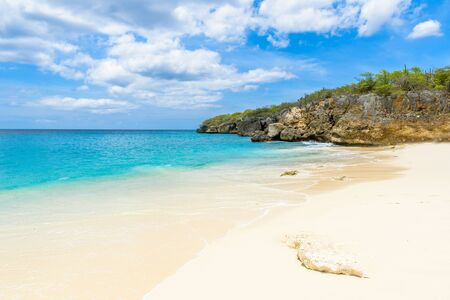Little Knip beach - paradise white sand Beach with blue sky and crystal clear blue water in Curacao, Netherlands Antilles, a Caribbean tropical Island Stock Photo