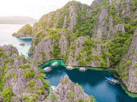 Aerial view of Twin Lagoon on paradise island with sharp limestone rocks, tropical travel destination - Coron, Palawan, Philippines.