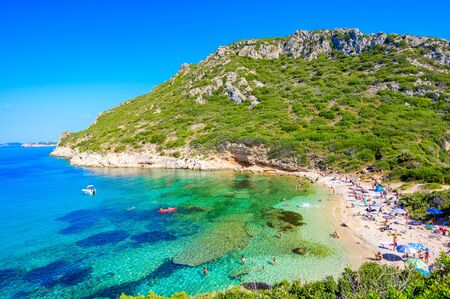 Porto Timoni beach at Afionas is a paradise double beach with crystal clear azure water in Corfu, Twin bay, Ionian island, Greece, Europe