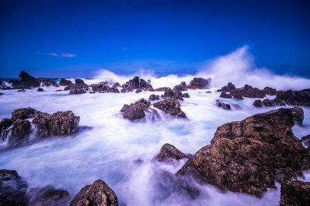 Porto Moniz - Long exposure of rocks and waves at vulcanic coast - beautiful landscape scenery of Madeira Island, Portugal