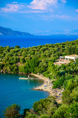 Spilios beach at Kommeno is close to Kerkyra is a paradise beach with crystal clear azure water in Corfu, Ionian island, Greece, Europe Stock Photo