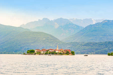 Isola dei Pescatori - fisherman island in Maggiore lake with mountains in the background, Borromean Islands (Isole Borromee), Stresa, Piedmont, Northern Italy - travel destination in Europe.