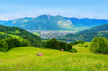 View from the top of Mountain Eckbauer to alps in the region of Garmisch-Partenkirchen, close to Zugspitze - Beautiful landscape scenery in Bavaria, Germany - Europe