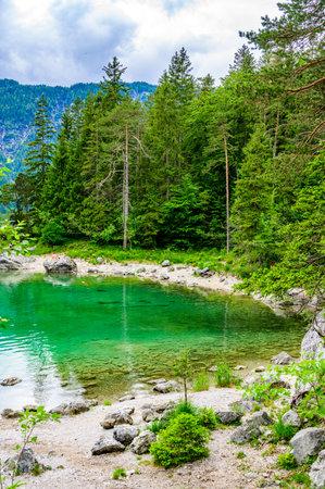 Eibsee lake  Zugspitze mountain in  background. Beautiful landscape scenery  paradise beach and clear  water in German Alps - Garmisch Partenkirchen, Grainau - , Germany, Europe.