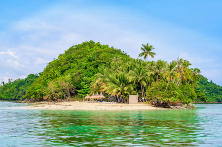 Inaladelan Island (also known as German Island) in Port Barton Bay with paradise white sand beaches - Tropical travel destination in Palawan, Philippines