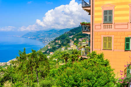 Camogli town in Liguria, Italy. Scenic Mediterranean riviera coast. Historical Old Town Camogli with colorful houses and sand beach at beautiful coast of Italy.