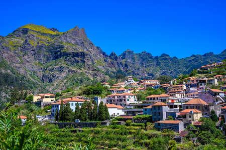 View of Curral das Freiras village in the Nuns Valley in beautiful mountain scenery, municipality of Câmara de Lobos, Madeira island, Portugal. Éditoriale