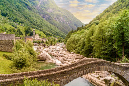 View of Bridge Ponte dei Salti to Verzasca River at Lavertezzo - clear and turquoise water stream and rocks in Ticino - Valle Verzasca - Valley in Tessin - Travel destination in Switzerland