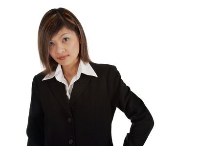 Young Asian female posed in business suit. Stock Photo