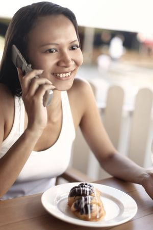 Young Asian Female Talking on a Mobile Phone Stock Photo - 4868272