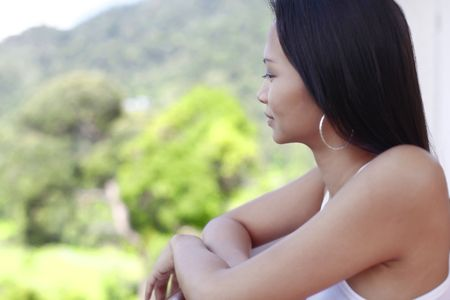 motionless: Young Asian Female Looking out at View Stock Photo
