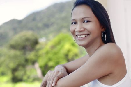 collarless: Young Asian Female Looking out at View Stock Photo
