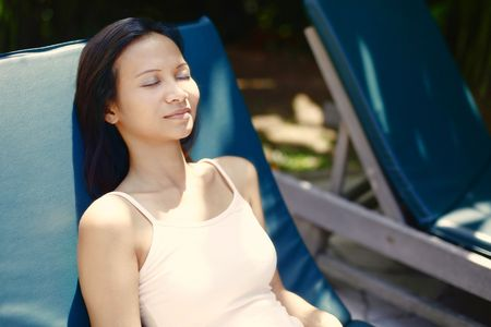 Young Asian Female Relaxing on a Reclining Chair