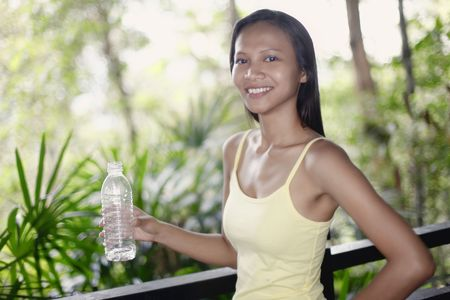 Young Asian Female Holding a Bottle of Water