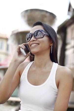 Young Asian Female Talking on a Mobile Phone