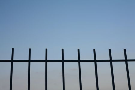 Railings Silhouetted Against an Evening Sky