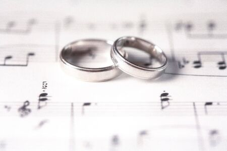 vellum: Two Wedding Rings on a Music Score