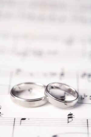 Two Wedding Rings on a Music Score