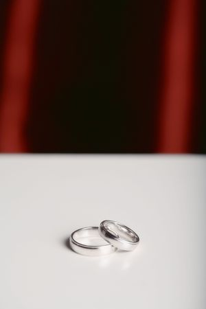 Two Wedding Rings with a Red Background
