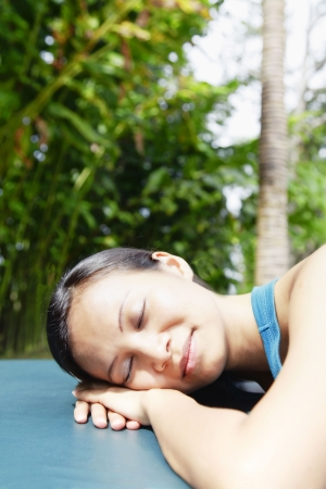 collarless: Young Asian Woman Laying and Resting on a Sun Lounger