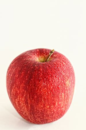Close up of a Fresh Red Apple with Water Droplets on the Surface