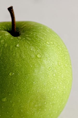 Close up of a Fresh Green Apple with Water Droplets on the Surface Stock Photo - 7656128