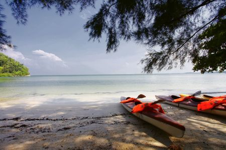 Scenic Landscape in Port Dickson, Malaysia with Kayaks on the Beach Stock Photo