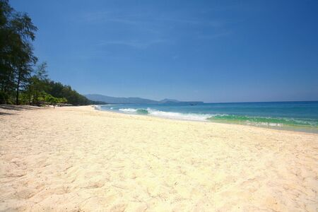 unwinding: View along Layan Beach, Thailand with a Beautiful Clear Blue Sky