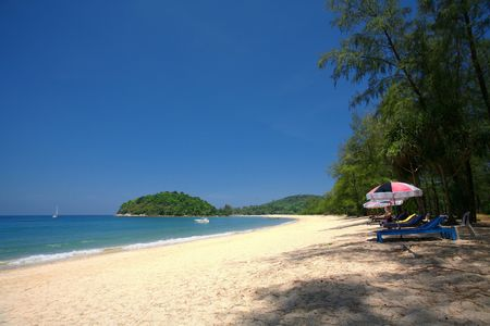 quite time: View along Layan Beach, Thailand with a Beautiful Clear Blue Sky