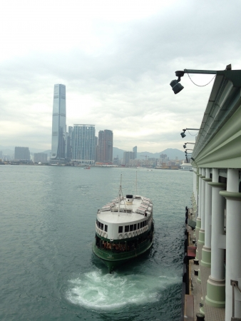 Star Ferry docking in Hong Kong harbor Stock Photo